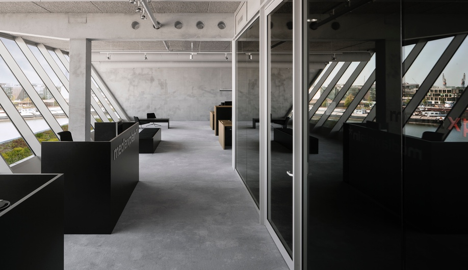 A striking media office by i29 interior architects azure for Interior design temp agency