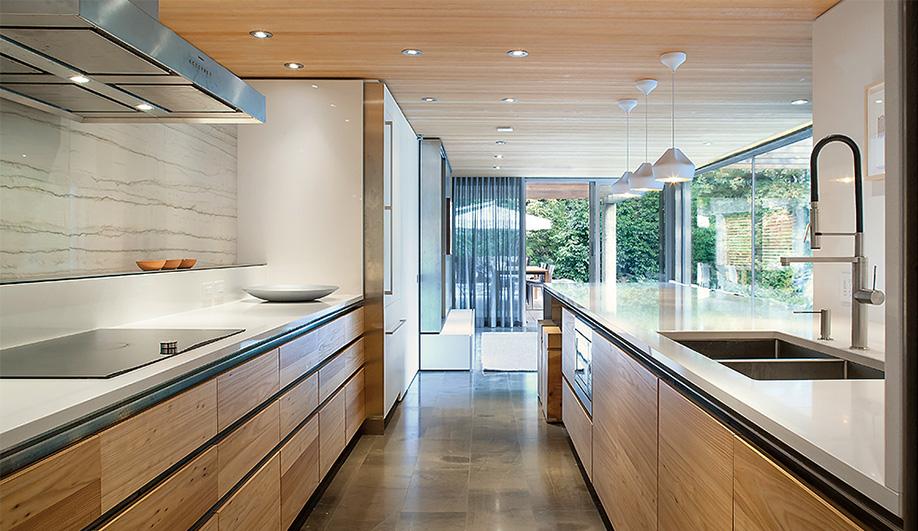 Elm veneer cabinetry and Corian work by Lauten Woodworking. Quartz counters by Bordignon Marble & Granite.