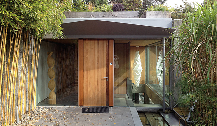 To stop rain leakage at the entrance, the firm added chevron-shaped canopies above the front door.