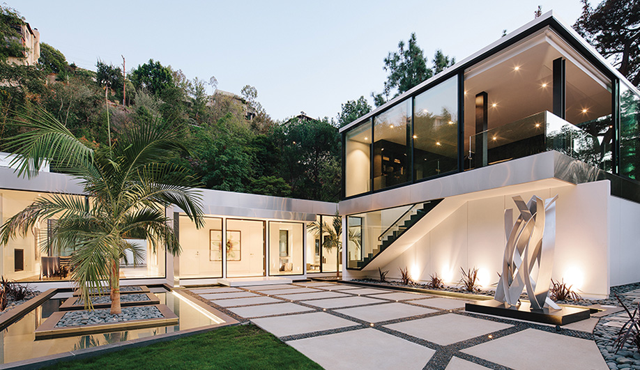 The landscaped entrance, with walkways surrounded by rocks, palm trees and water, is eye-catching yet easy to maintain.