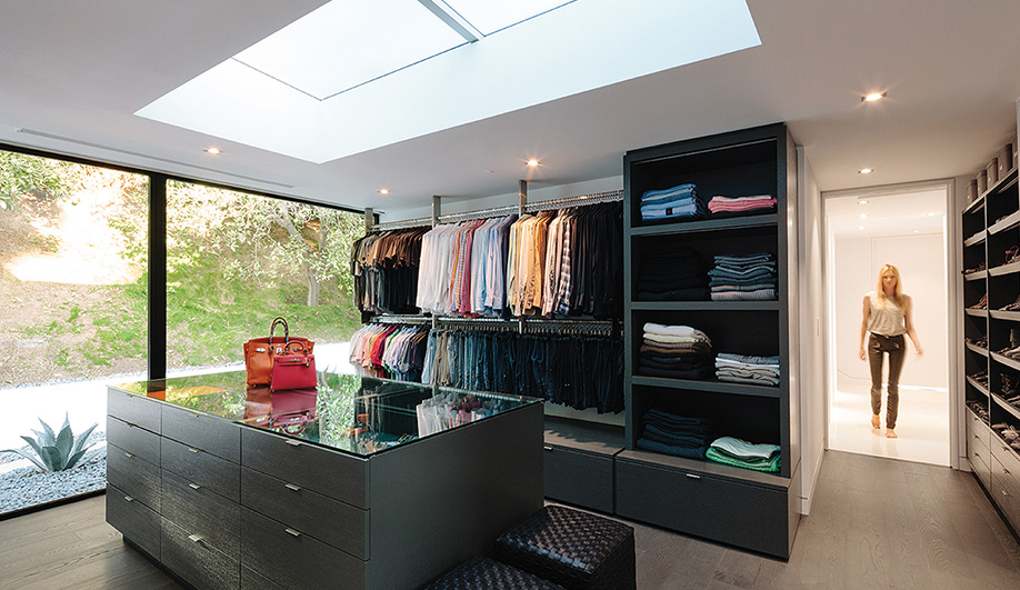A room-sized wardrobe overlooking the garden features rift-cut white oak shelving and drawers.