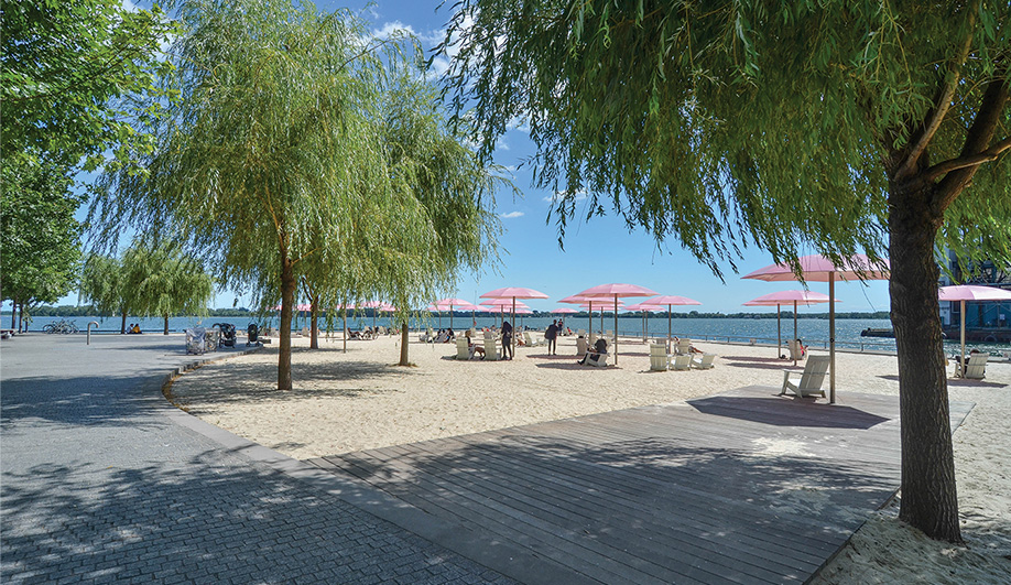 Sugar Beach, a triangular park filled with pink umbrellas and white sand, has won numerous awards since it opened. The park was designed by Claude Cormier + Associés of Montreal.