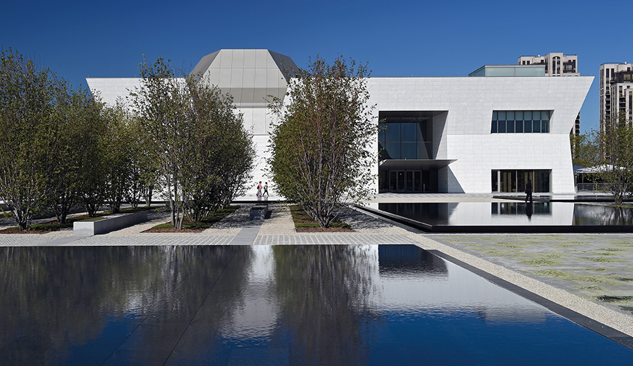 Reflective pools and tree groves provide a contemplative garden between the aga khan museum and the Ismaili Centre.