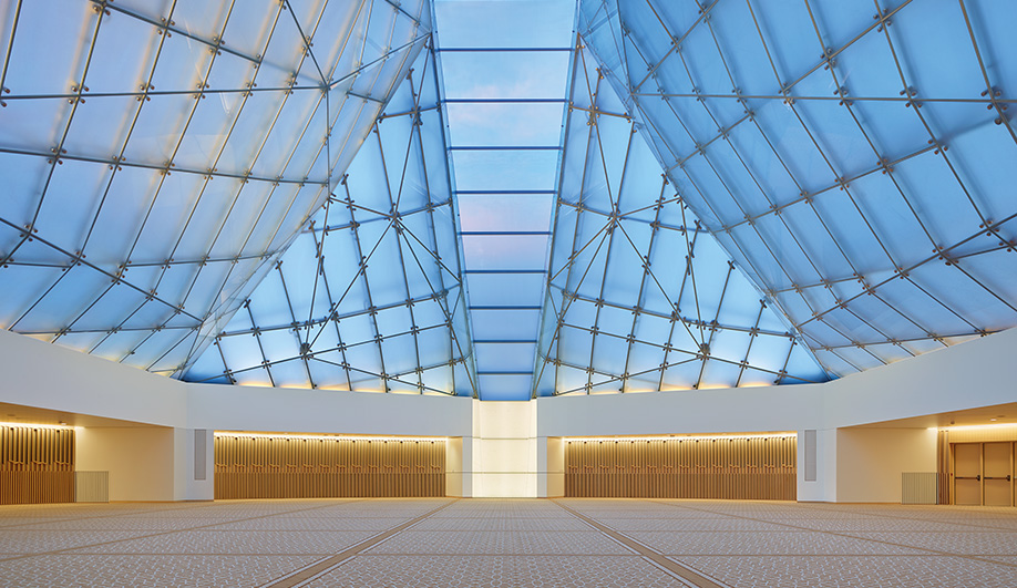 The Ismaili centre's prayer hall dome, by charles Correa associates, consists of frosted glass panels, with a central spine facing mecca.
