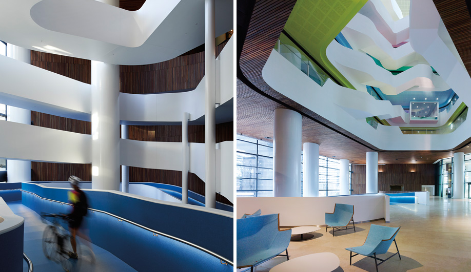 Left: A ribbon-like blue ramp traverses four levels and invites employees to bring their bikes into the building's storage facility. Right: The atrium's spiral of colour-coded ceilings and floors are an effective wayfinding feature for navigating the seven floors where 1,600 employees now work.