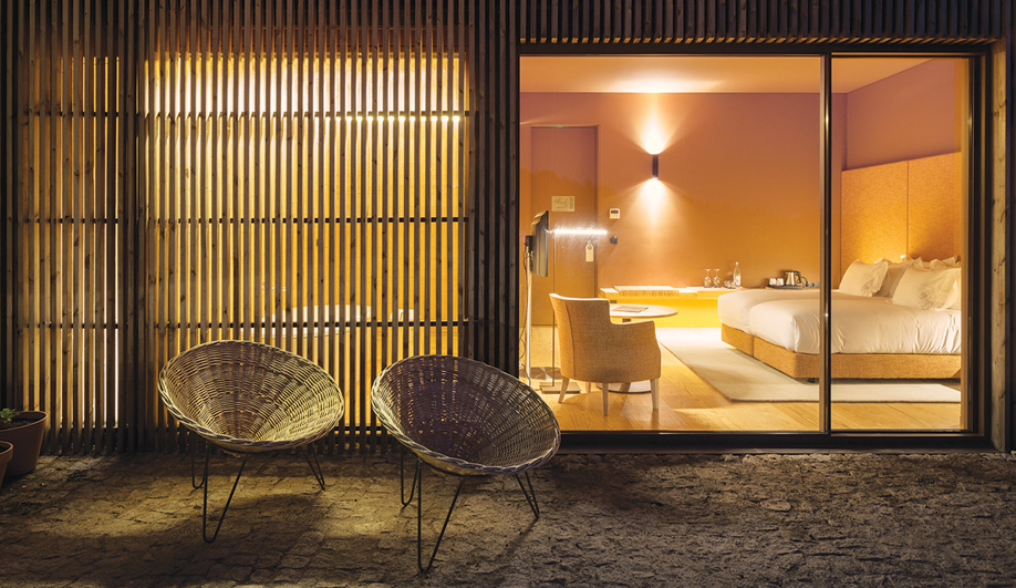 Many of the suites feature generous terraces, furnished with distinctive conical chairs handmade in Portugal.