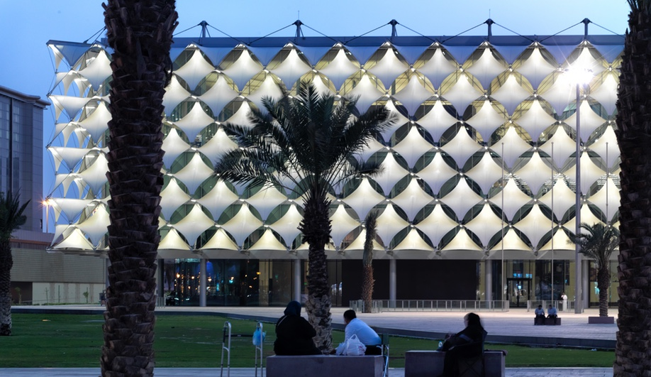 King Fahad National Library, in Riyadh, Saudi Arabia, was designed by Gerber Architekten International. The new building's cuboid shape, shielded by sun shades, wraps the old 1980s librarby on all sides.