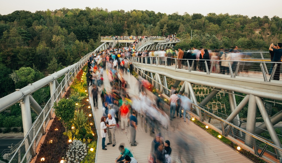 Tabiat Pedestrian Bridge, in Tehran, was designed by Diba Tensile Architecture / Leila Araghian, Alireza Behzadi. The three-level bridge, completed in 2014, connects two parks and is a popular gathering spot for locals.