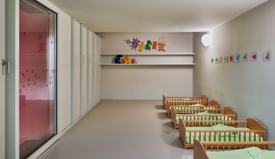 Nursery school design elevated  a napping room features pint sized