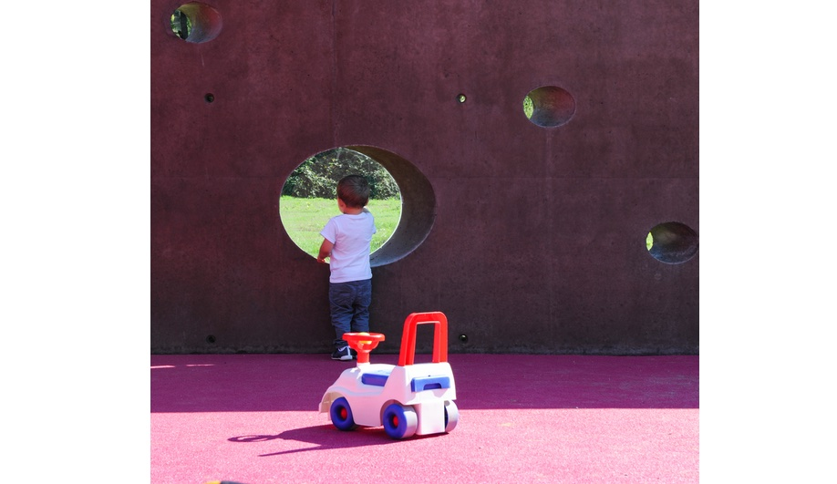 Nursery school design, elevated: the outdoor perimeter wall, with circular openings to peer through