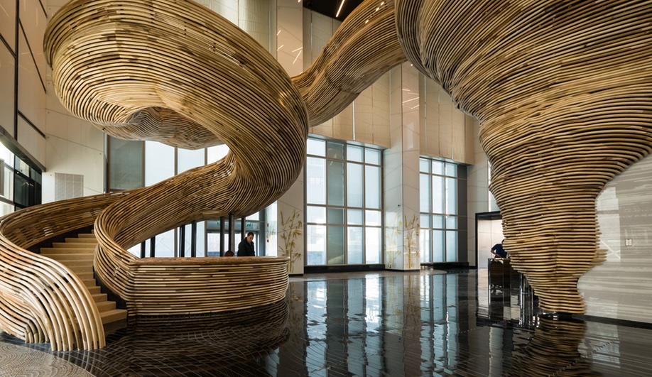 A Sculptural Staircase Swirls Through a Tel Aviv Lobby