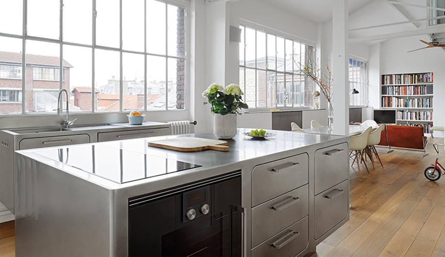 Paris loft with an all-stainless steel kitchen