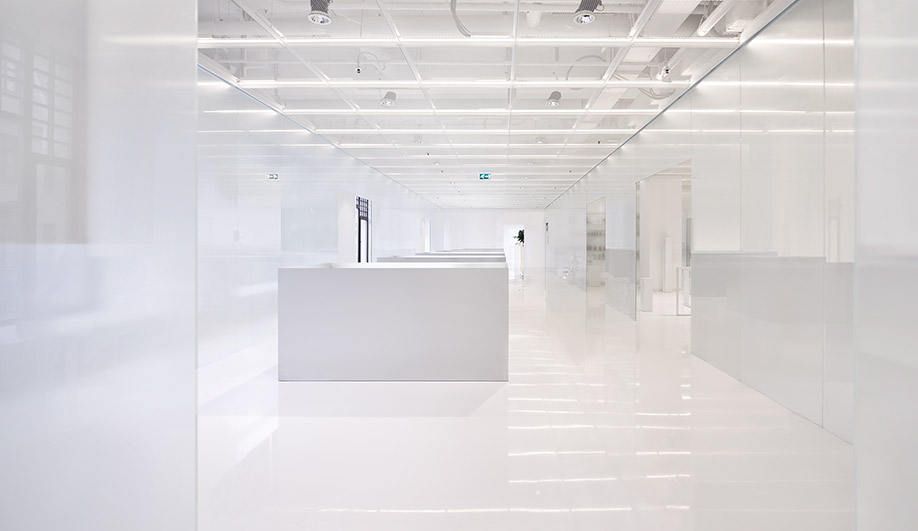 Translucent wall panels divide shopping areas from galleries and open spaces, recreating a futuristic look Stanley Kubrick would have loved.