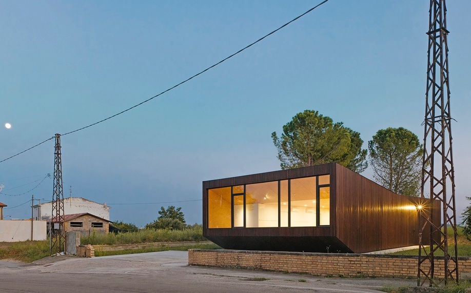 A Modern Community Space in a Rustic Italian Village