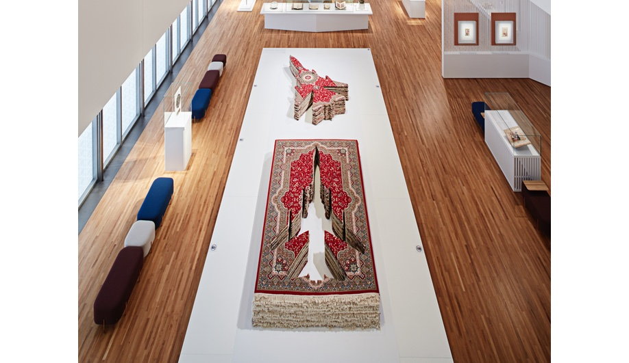 'Flying Carpet', a fighter jet made from 32 stacked Persian carpets, by Farhad Moshiri, 2007.