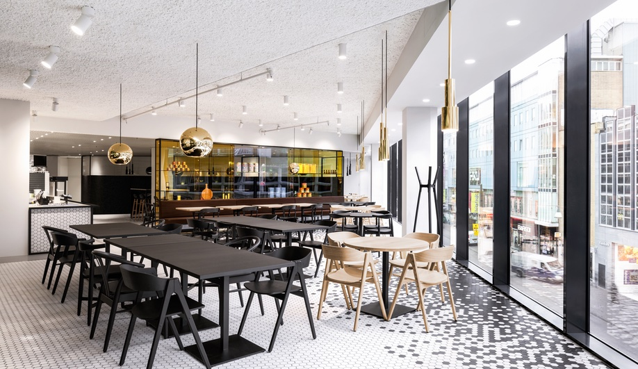 I29 interior architects covers a restaurant in hexagon tiles azure