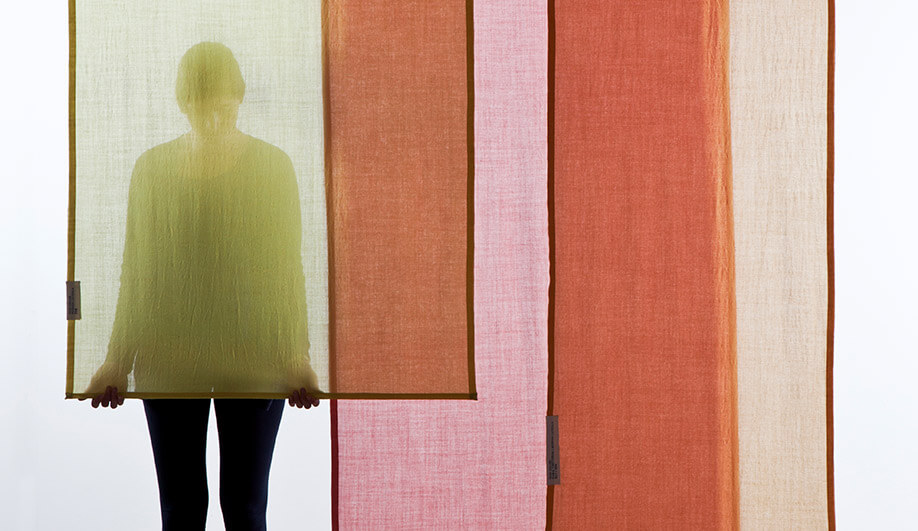 Eindhoven studio Raw Color plays with hue gradation through the layering of sheer curtain panels.