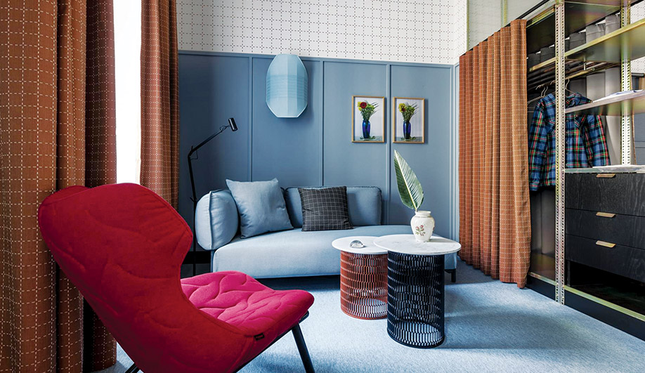 The wall coverings, curtains and quilted chairs showcase Urquiola's varied material palette.