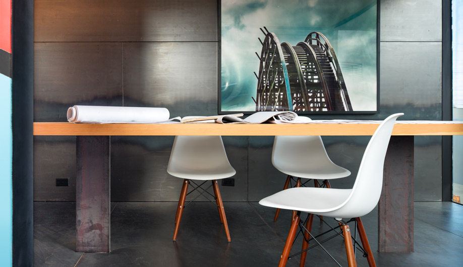 The largest unit features a conference table and custom glass slider.