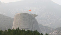 A Circular Steel Structure on a Hilltop in China Lets Monks Fly