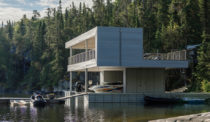 A Boathouse in Ontario Fosters Lakeside Fun for a Young Family