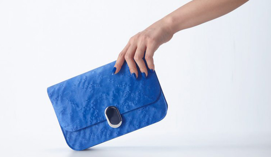 The Supple bag by Tokyo studio Design For Industry is made by bonding natural leather to brilliantly dyed birdseye maple veneer.