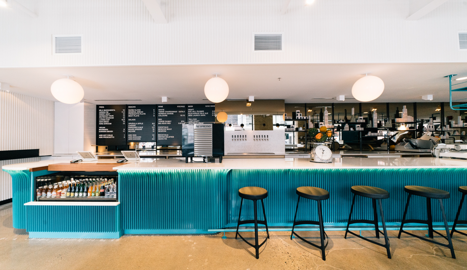 A powder-coated teal bar is one of the focal points at General Assembly Pizza in Toronto.