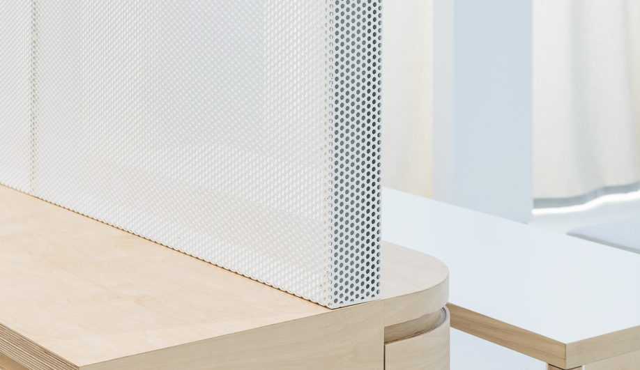 The Everlane flagship maintains its translucency with perforated metal dividers.