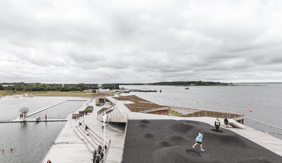 This Aalborg swimming pool has green roofs that mimick meadows on the mainland.