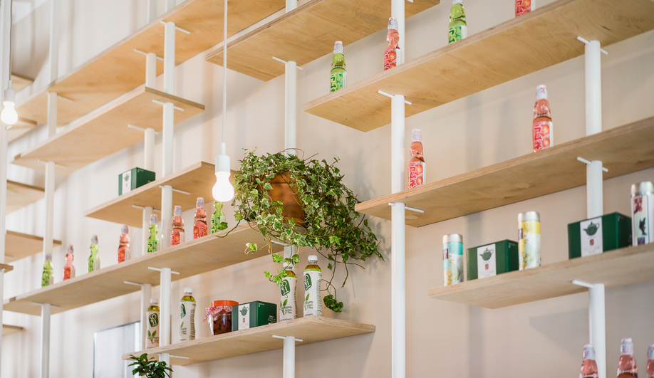 Japanese products line the walls of Warsaw's Vegan Ramen Shop.