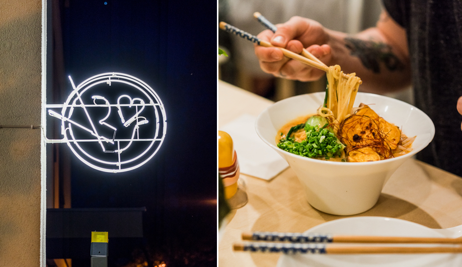A pictographic neon sign welcomes visitors to Warsaw's Vegan Ramen Shop.