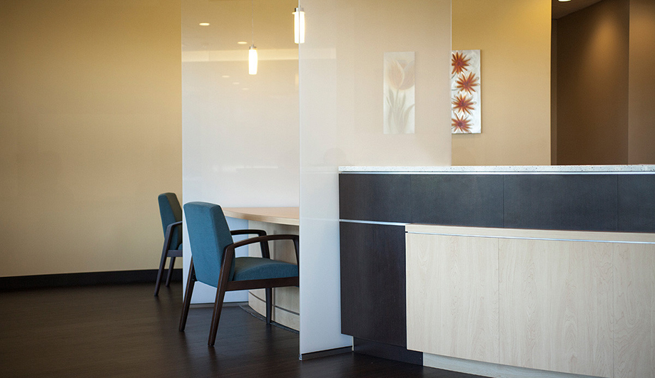 Forms+Surfaces glass: ViviGraphix Gradiance glass keeps the look light and proves that privacy can be a beautiful thing in these reception desk partition panels.