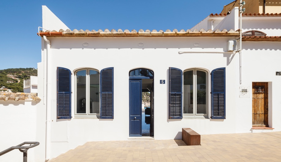 Es Garbi, Nook Architects' Catalonian beach house restoration, steps down to the ocean.