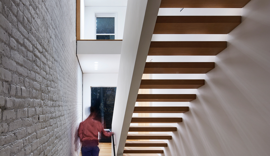 A Row House Transformed By A Set of Switchback Stairs