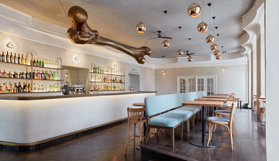 Prague's NoD Cafe is Defined by a Giant Bone-Shaped Sculpture
