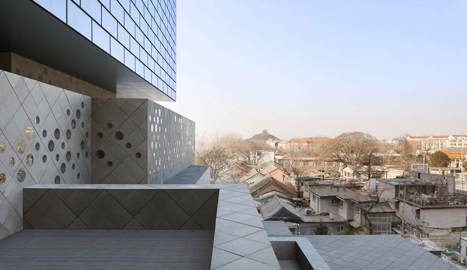 The Guardian Art Center echoes nearby hutongs.