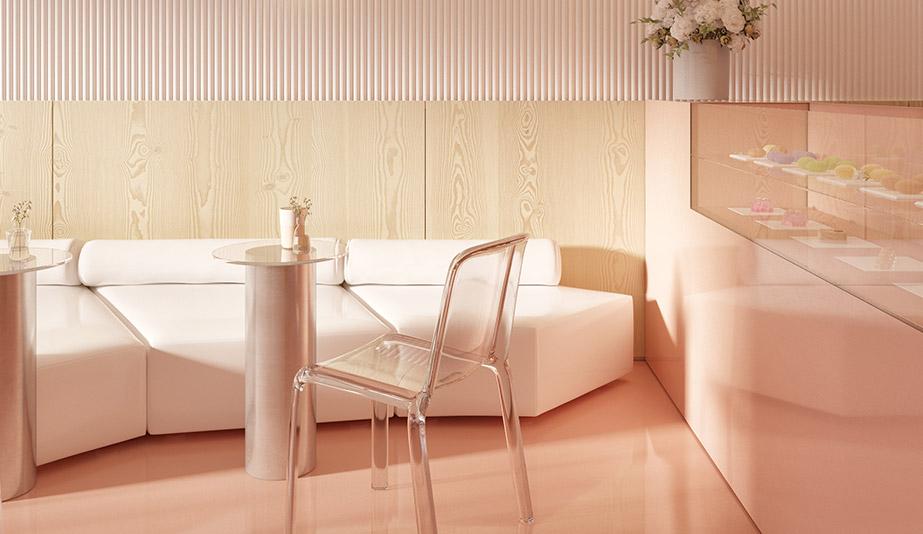 A white upholstered bench runs the length of Kiev's Amai Hana, designed by Z. River Studio.