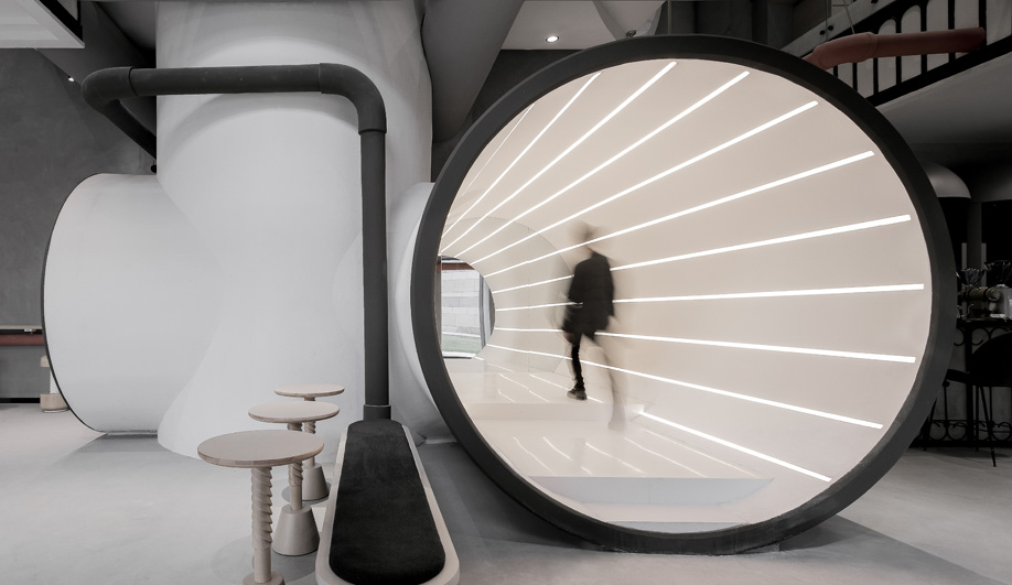 An illuminated tube walkway at Ideas Lab Shanghai by X+Living