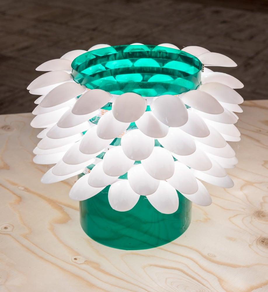 Designer Bertjan Pot's experimental lamp made from plastic spoon heads