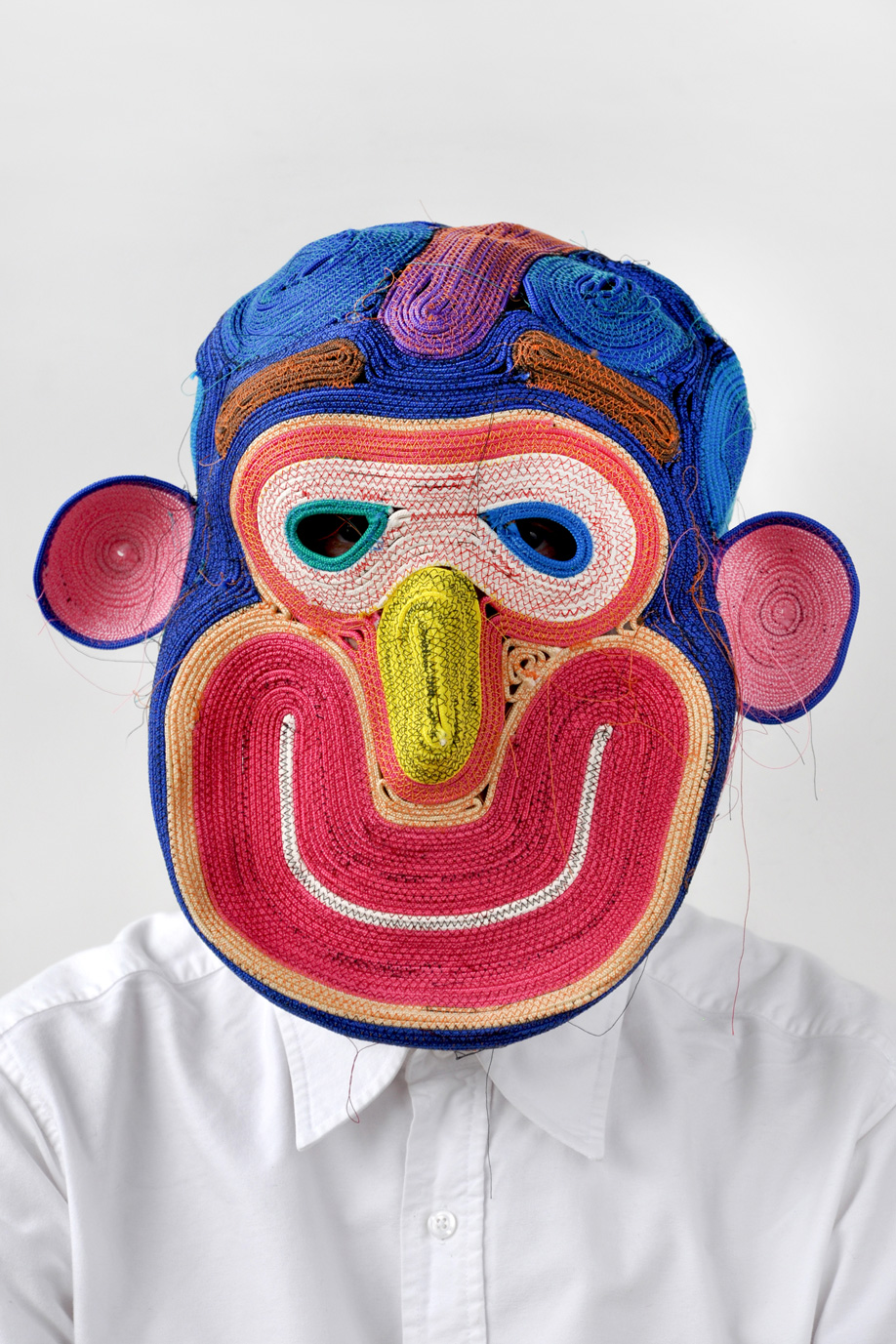 Designer Bertjan Pot with a colourful rope-woven mask