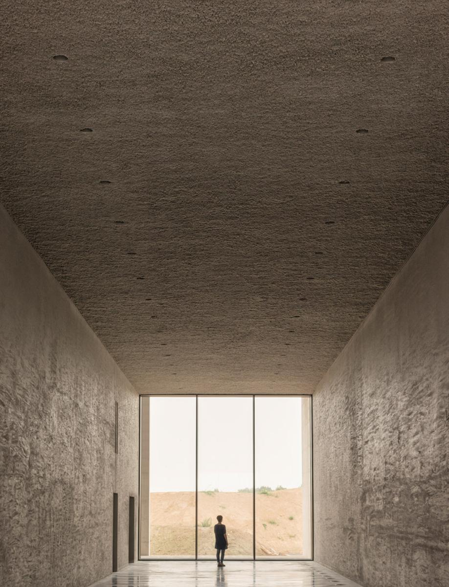 Floor-to-ceiling windows in KAAN Architecten's modernist Crematorium Siesegem