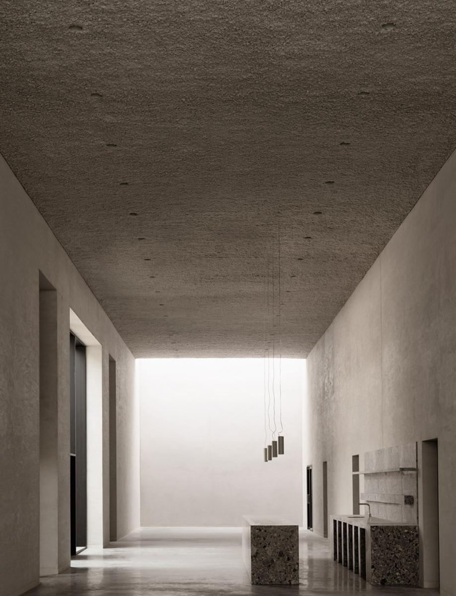 The reception area in KAAN Architecten's modernist Crematorium Siesegem