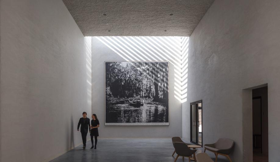 A hallway in KAAN Architecten's modernist Crematorium Siesegem