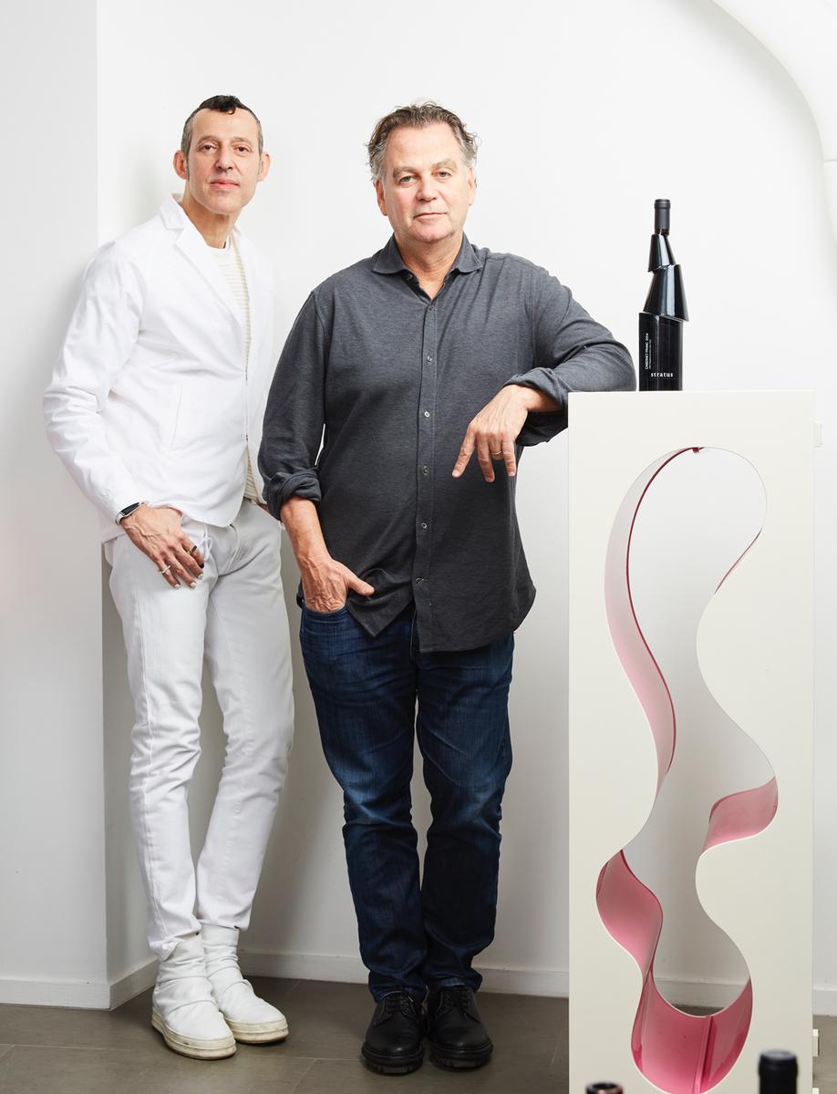 Karim Rashid (left) poses with Stratus CEO and president David Feldberg.