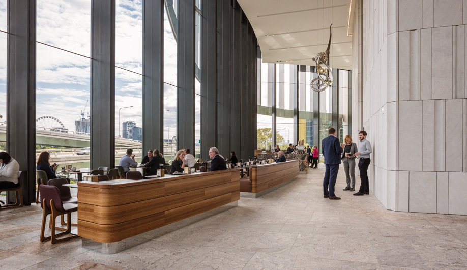 A gathering space in 1 William Street, a village-inspired government office building designed by Woods Bagot.