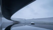 A Bold Circular Bridge Defines Waterfront Art Gallery in Nanchang