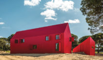 A Bright Red, Dramatically Peak-Roofed Home in Portugal