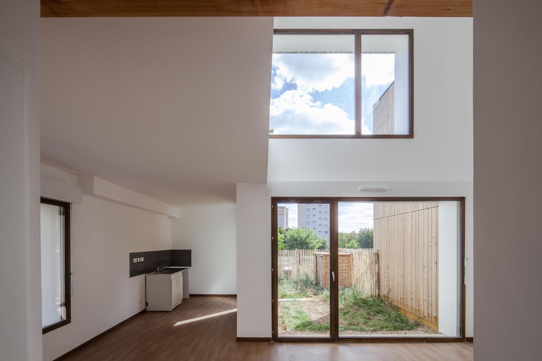 NZI architectes, straw bale social housing