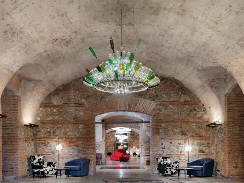 A custom wine bottle chandelier by Ingo Maurer.