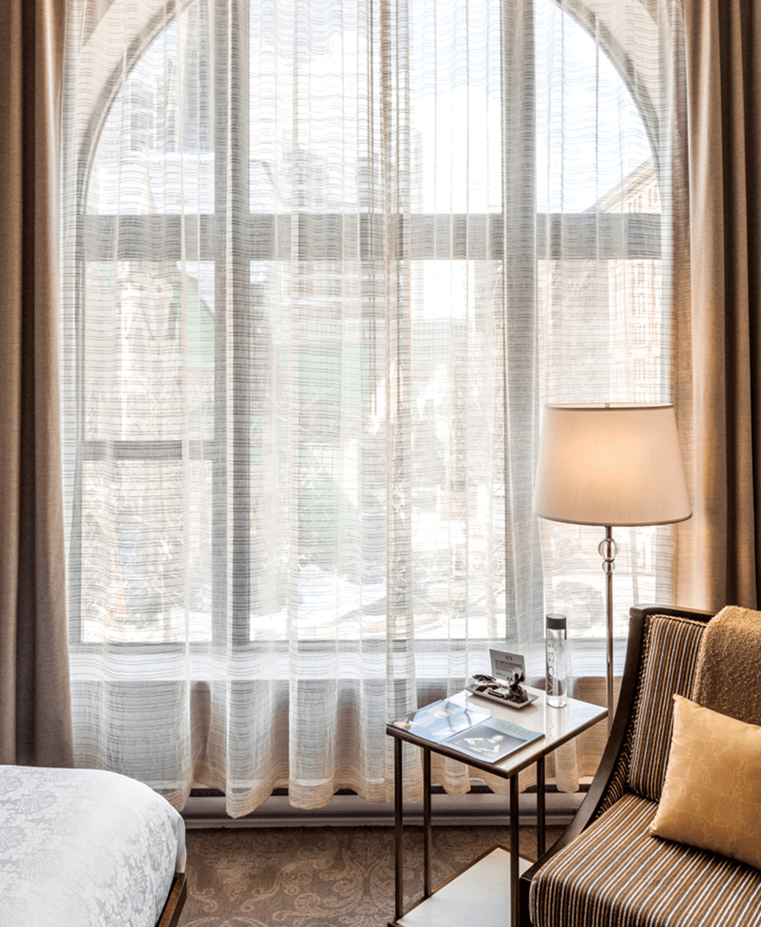 Unusually high ceilings and grand arched windows distinguish many of the rooms in the oldest part of the Hotel Birks Beaux Arts building